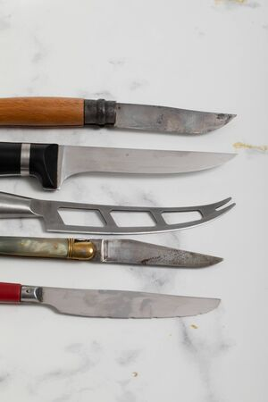 A professional isolated kitchen knife on a white marble background. steel kitchenware 版權商用圖片 - 147137816