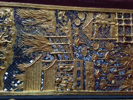 art: Gold relief and mirrow mosaic art on temple door