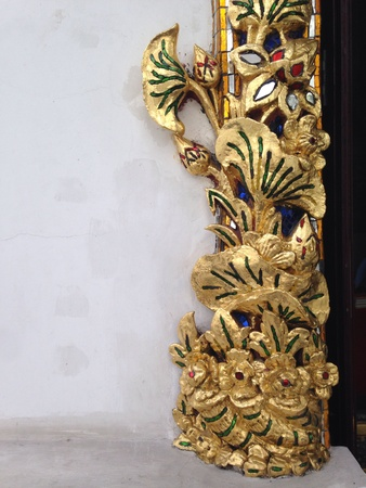 gold: Gold relief and mirrow mosaic on a wall  thai temple