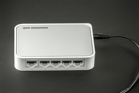 network port: Five port Network switch on black background Stock Photo