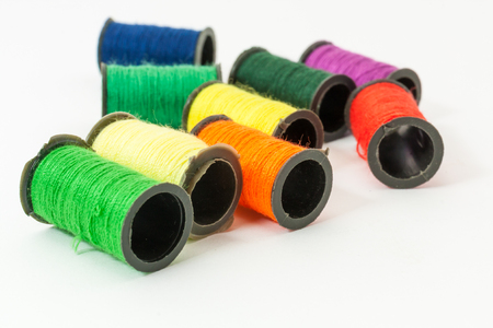 bobbin: Collection of Colorful bobbin threads lying using for embroidery works