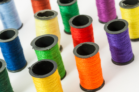 sewing machines: Colorful bobbin threads arranged in up right position using for embroidery works