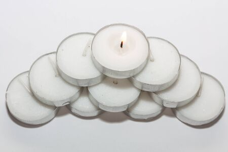 tea candle: Round Tea Candle lights arranged in a pyramid shape. Christmas lighting