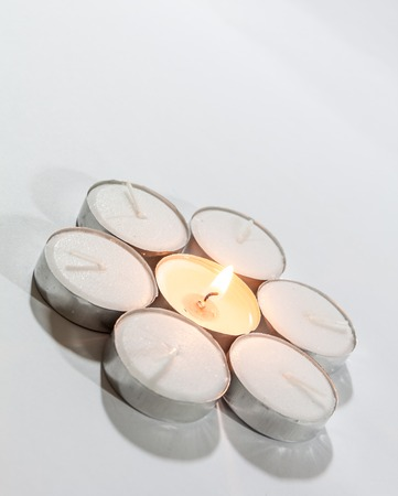 tea candle: Round Tea Candle lights arranged in round shape with center candle lit. Christmas lighting