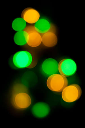 Blurred spots of green and yellow lights bokeh for abstract color background