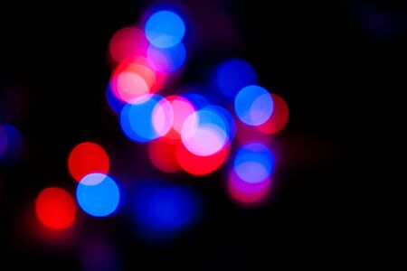 Blurred spots of red and blue lights bokeh for abstract color background