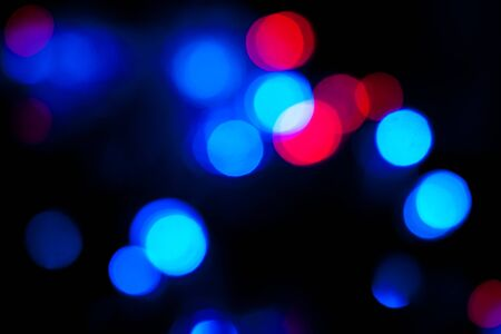 Blurred spots of blue and red lights bokeh for abstract color background
