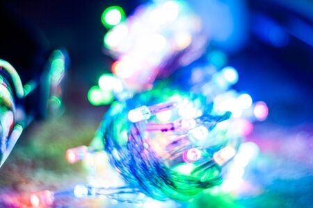 Blurred different colors christmas lights for abstract color background