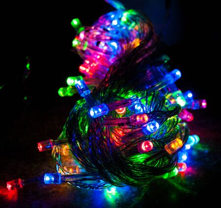 Red, blue, green and orange colored led christmas lights in night