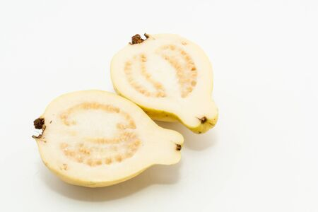 two pieces: Guava fruit cut into two pieces on white background Stock Photo