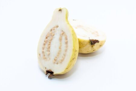 Guava fruit cut into two pieces on white background Stock Photo