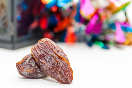 Two date fruits on colorful background.Ramadan Eid concept
