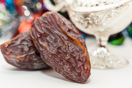 Date fruits and silver alaadins lamp. Ramadan Eid concept