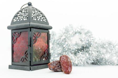 Date fruits and arabic lantern. Ramadan Eid concept