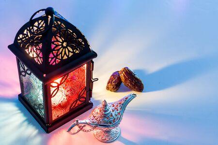 Date fruits,Aladdins lamp and arabic lantern. Ramadan Eid background concept