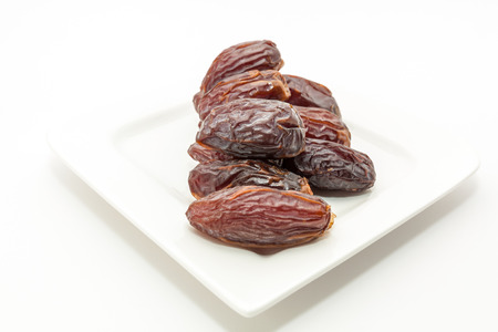 Date fruits in white plate . Ramadan, Eid background concept.