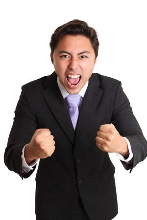 Screaming businessman holding up his fists  Wearing a suit and tie  White background