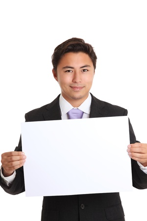 Businessman showing a blank paper wearing a suit and tie  White background  Stock Photo