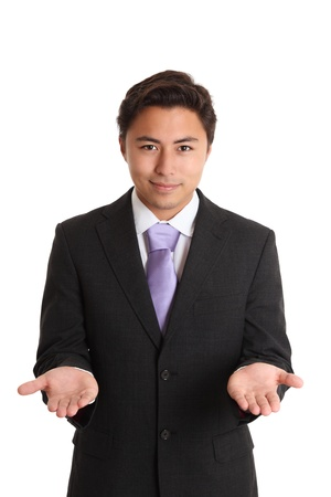 Left or right. A young businessman holding up his hands, wearing a suit and tie. White background.