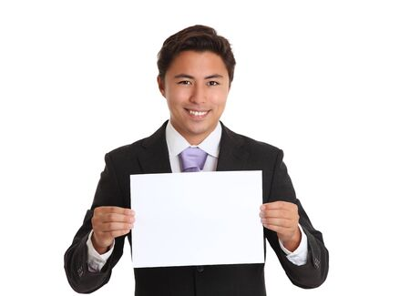 Happy businessman wearing a suit and tie holding a blank paper. White background.