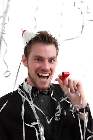 Partys ON!! Party guy with hat and party blower. Wearing a suit. White background. photo