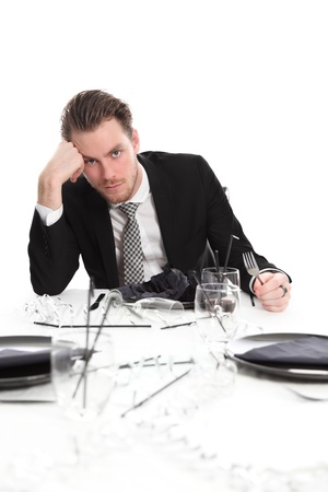 Party guy with a worried look. Wearing a black suit and tie. White background.