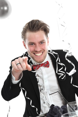 Party guy pointing at YOU. Wearing a black suit and bowtie. White background. photo