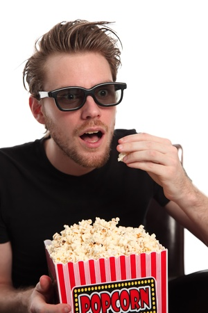 Amazed man in 3D-glasses with a popcorn bowl. Wearing a black t-shirt. White background. photo