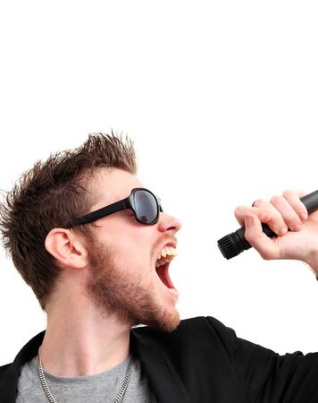Rock n roll guy screaming into a microphone. Wearing sunglasses and a jacket. White background. photo