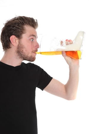 Beer drinker. Man with a boot shaped beer glass wearing a black t-shirt. White background. photo