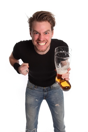 playful behaviour: Lets WIN! Man holding a boot shaped beer glass. Closed fist. White background. Stock Photo