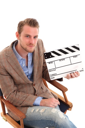 Man holding a film slate sitting down in a directors chair. White background. photo