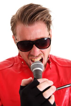 Rock Star. Man in a red leather jacket screaming into a microphone. White background.  photo
