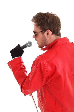 Rock Star. Man with a microphone, wearing a red leather jacket and sunglasses. White background. photo