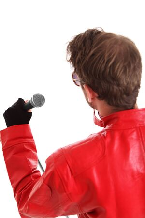 Rock Star. Holding a microphone, wearing a red leather jacket and sunglasses. White background. photo