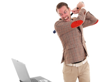 Businessman about to smash a laptop computer wearing a suit and tie. White background. photo