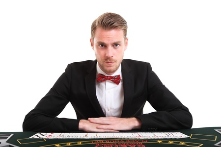 Blackjackdealer in a suit and bowtie. White background. photo