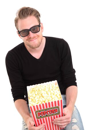 Man in 3D-glasses with a popcorn bucket, sitting down. White background. photo