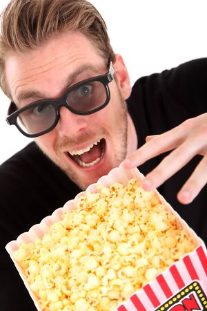 Man in 3D-glasses with a popcorn bucket, sitting down  White background Stock Photo - 17362466