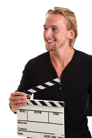 Man holding a film slate. Wearing a black shirt. White background. photo