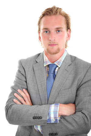Serious young businessman in a grey suit. White background.  photo