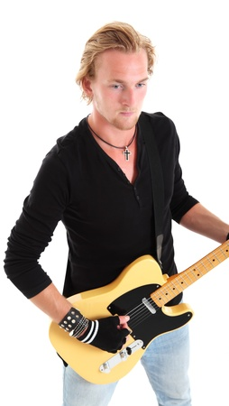 Cool looking rocker with a yellow guitar wearing a black shirt. White background. photo