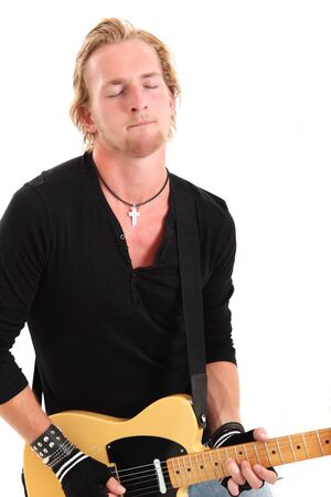 Rocker with closed eyes playing guitar, wearing a black shirt. White background. photo