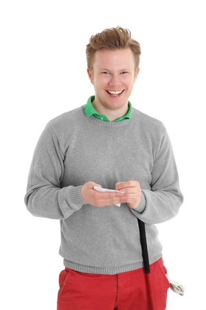 Happy golfer writing score card. Wearing a grey pull over. White background. Stock Photo