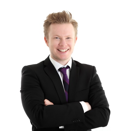 Young happy businessman. Wearing a black suit with a purple tie. White background. photo