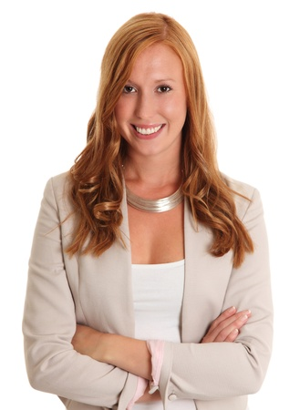 Smiling businesswoman with her arms crossed  Red hair and a bright jacket  White background  photo
