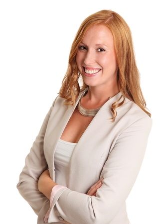Smiling businesswoman with her arms crossed  Red hair and a bright jacket  White background  Stock Photo - 17387562