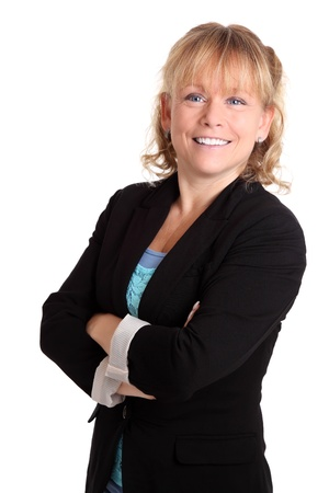 Smiling businesswoman wearing a jacket, her arms crossed  White background