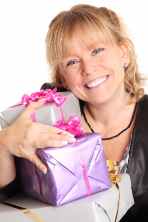 hat new year s eve: Happy woman with presents  Wearing a black jacket  White background  Stock Photo