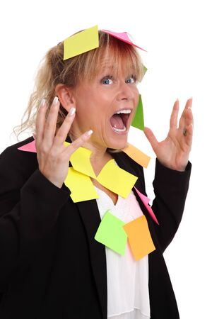 Screaming businesswoman with post-it notes. White background. photo